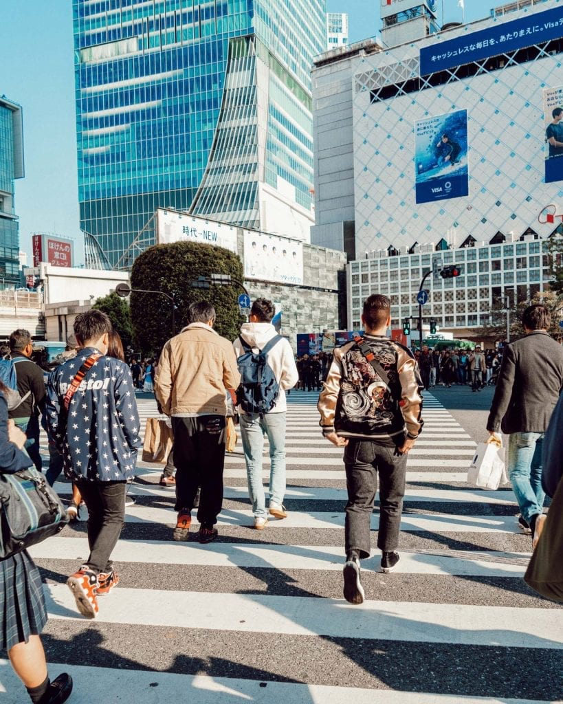 Kyle Legg running into the Shibuya Crossing in Tokyo