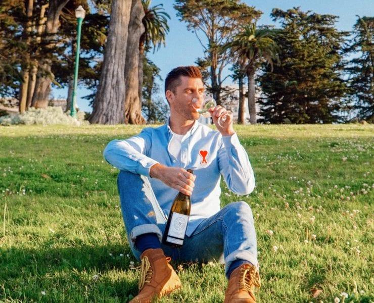 Kyle Legg, The Cosmopolitan Man, sipping Priest Ranch wine in San Francisco's Alamo Square Park.