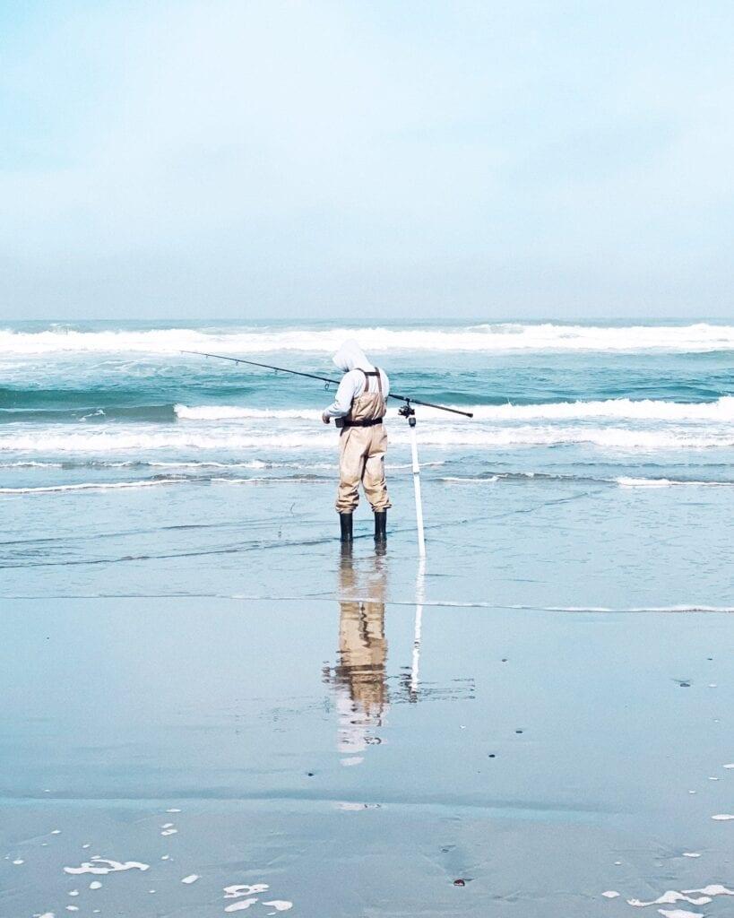 Socially distanced fisherman on Ocean Beach during COVID-19 coronavirus lockdown in San Francisco, CA. 49 Miles.